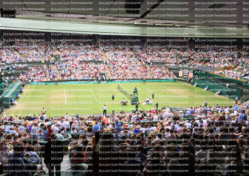 The spectators fill every seat at the Championship Wimbledon at Centre Court in Wimbledon, London.