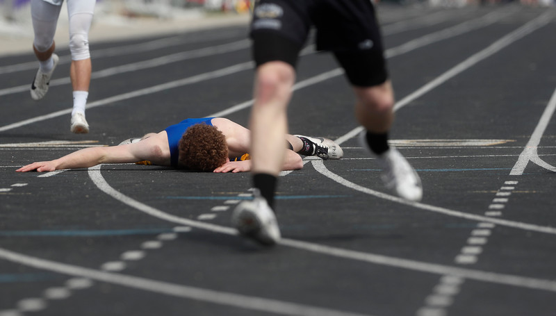 Scobey-Opheim's Martin Farver lies on the track after falling across the finish line to win the boys 400-meter dash during the State C track meet at Laurel Sports Complex in Laurel, Mont. on Friday, May 24, 2019.
