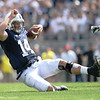 Quarterback Christian Hackenberg (14) slides for a first down in the third quarter of Penn State's 45-7 victory over Eastern Michigan on Saturday.<br /> ©The Daily Collegian