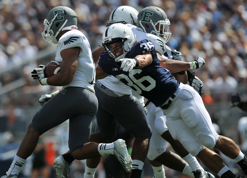 Penn State linebacker Hunter Crafford (36) dives to tackle Eastern Michigan running back Tyler Allen (11) in the first half of the Nittany Lions' 45-7 victory over the Eastern Michigan Eagles.<br /> ©The Daily Collegian