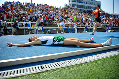 Glenbard West's Mike Lederhouse lays in exhaustion after fiinishing the Class 3A 1600-Meter Run at the Track & Field State Finals, Saturday, May 26th, 2012 in Charleston, IL.   Gary Middendorf~For Sun-Times Media