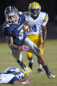 10/14/2011 - B.J. Bunn of Western Alamance High School runs past Quan Moss, bottom, of  Eastern Guilford High School at Friday's game at Western Alamance. Photo Stuart Jones