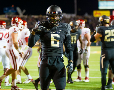 #6 Ahmad Dixon celebrates in the end zone after making a crucial stop on OU.
