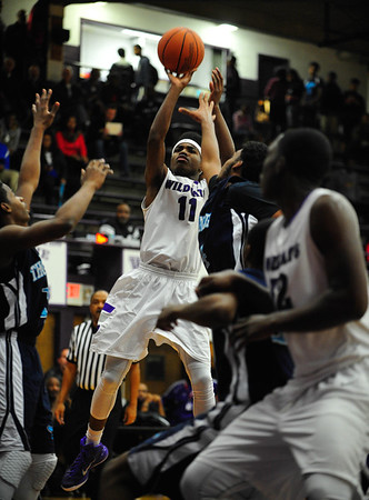 DeQuan Applewhite, of Thornton, puts up a three point shot against Thornridge at Thornton, Friday, December 12th, 2014, in Harvey.   Gary Middendorf/ Chicago Tribune Media Group