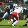 Penn State defensive tackle Kyle Baublitz (84) blocks Nebraska quarterback Ron Kellogg III (8) during a play in the third quarter of Penn State's 23-20 overtime loss to Nebraska November 23, 2013.<br /> ©The Daily Collegian