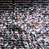 Blurred crowd spectators watching the tennis match at Centre Court, Wimbledon.
