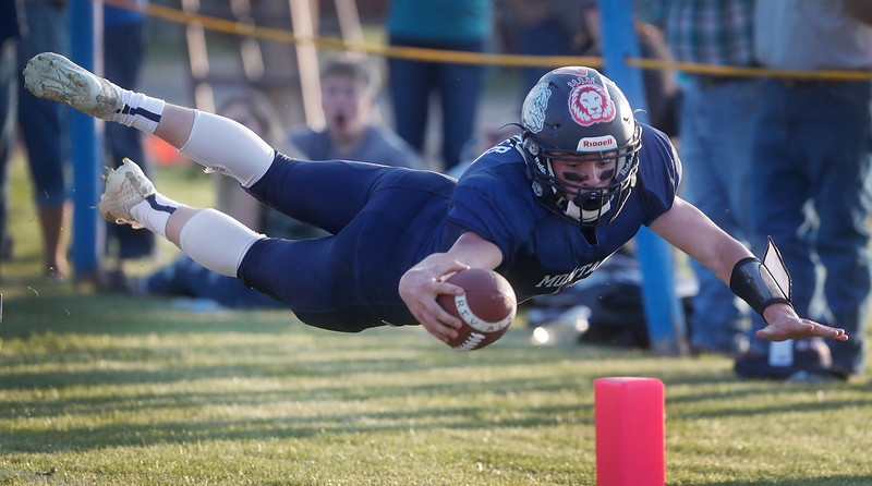 Blue All-Star's Aj Ullmer reaches for an unsuccessful touchdown during the second quarter of the annual 6-Man All-Star game at Hoffman Field in Custer, Mont. on Saturday,  June 1, 2019.