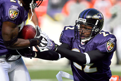 Chris Ammann/Baltimore Examiner Ravens cornerback Samari Rolle, right, hands the ball to safety Ed Reed, turning an interception into a Baltimore touchdown during the first quarter Sunday, Nov. 5, 2006 at M&T Bank Stadium in Baltimore.