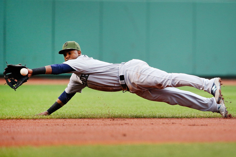 Jean Segura #2 of the Seattle Mariners dives for a ground ball in the first inning of a game against the Boston Red Sox at Fenway Park on May 28, 2017 in Boston, Massachusetts.
