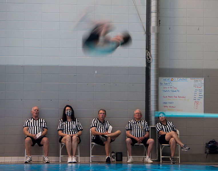 Judges watch as Poudre's Brodie Marsh competes in the 1-meter diving during the city meet at the Edora Pool Ice Center in Fort Collins, Colo. on Saturday, June 12, 2021.