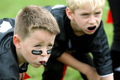 Chris Ammann/Baltimore Examiner<br /> Jake Dickerson, left, and teammate Jack Shuman have their game faces on as they line up at the line of scrimmage.
