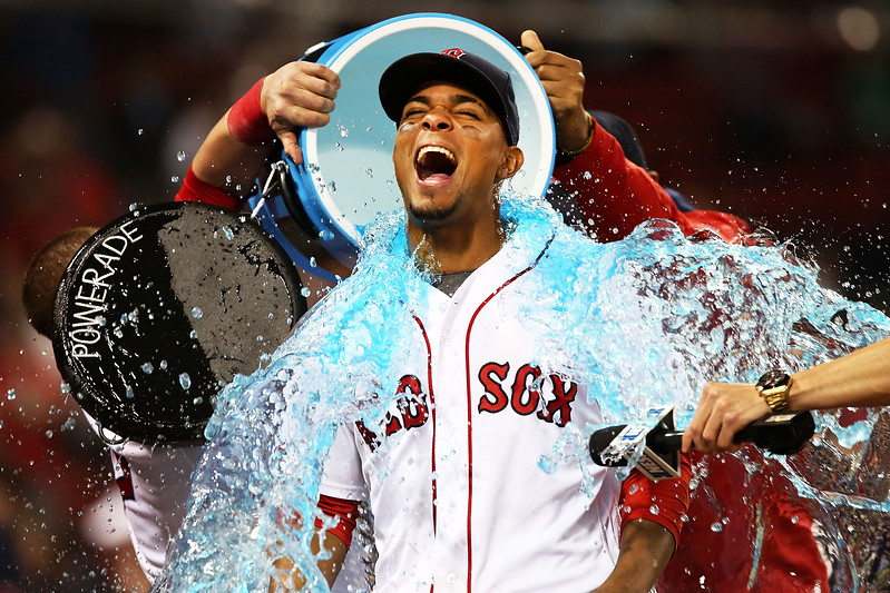 Xander Bogaerts #2 of the Boston Red Sox has Powerade dumped on him after the victory over the Houston Astros at Fenway Park on May 12, 2016 in Boston, Massachusetts.