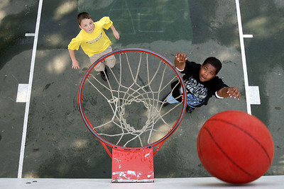 Chris Ammann/Baltimore Examiner Vernard Smith, 13, right, uses the backboard to make his shot while playing basketball with John Grob, 13, at Dulaney High School in Timonium on Wednesday, May 17, 2006.