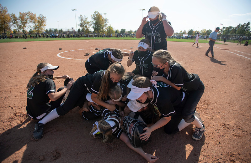 Fossil Ridge celebrates their victory over Cherokee Trail to earn the state title in the Class 5A state softball championships at Aurora Sports Park in Aurora, Colo. on Saturday, Oct. 10, 2020.