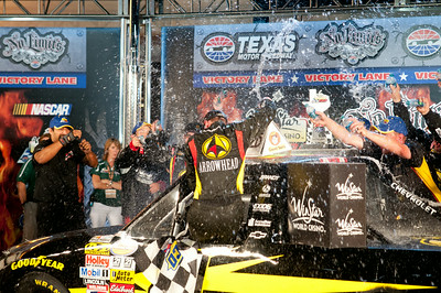 #4 Jeb Burton is sprayed with water in Victory Lane after wining the WinStar 550