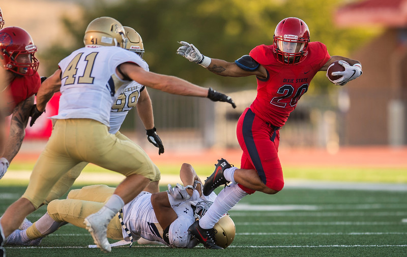 Dixie State University running back Lawrence Starks (20) peels himself away from a South Dakota Mines defender at Sark Arslanian Field Saturday, September 22, 2018.