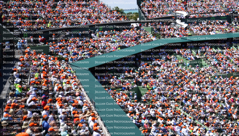 Blurred crowd spectators watching the tennis match at the Miami Open.