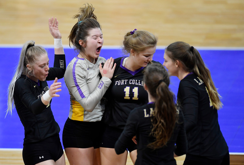 Fort Collins celebrates a point in the second set of the game against Cherry Creek in the first round of the 5A state volleyball tournament at Denver Coliseum in Denver, Colo. on Thursday, Nov. 14, 2019.