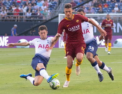 Benjamin Davies, left, of Tottenham Hotspur tackles Patrik Schick, right, of AS Roma during the Hotspurs 4-11 victory over Roma in San Diego, CA on Wednesday, July 25, 2018.