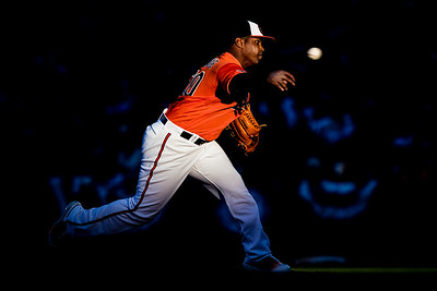 Baltimore Orioles pitcher Mychal Givens (60) throws at sunset during an MLB game against the New York Yankees at Oriole Park at Camden Yards in Baltimore, Maryland.
