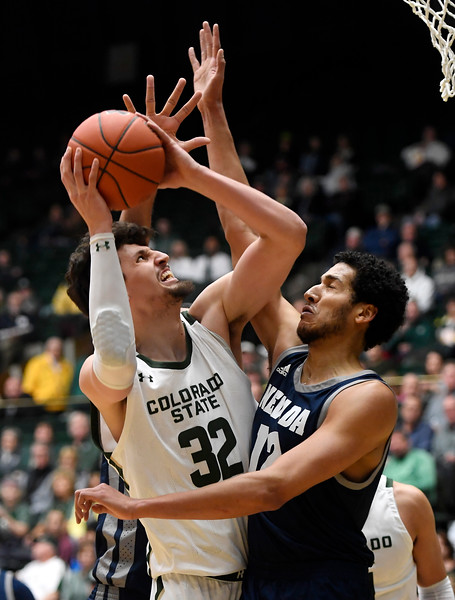 Colorado State Rams center Nico Carvacho (32) looks to shoot as Nevada Wolf Pack forward Johncarlos Reyes (12) blocks during the first half of the game at Moby Arena at Colorado State University in Fort Collins, Colo. on Wednesday, January 29, 2020. Mandatory Credit: Bethany Baker/The Coloradoan via USA Today Network.