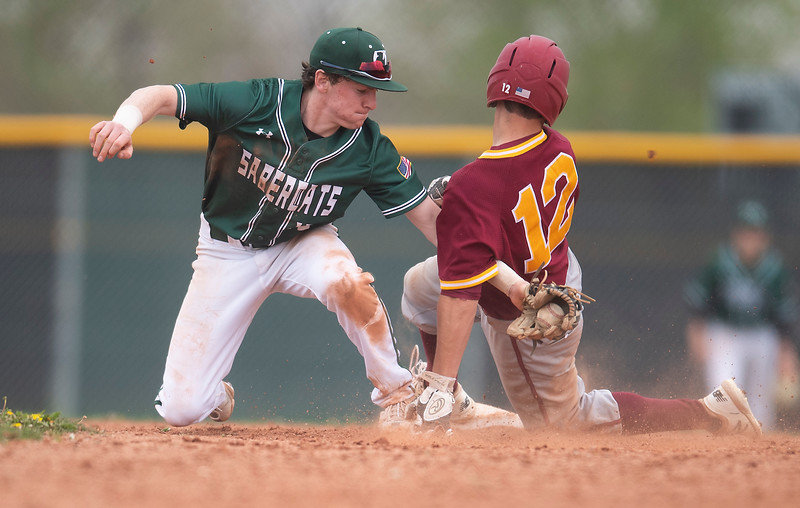 Fossil Ridge's Tate Johnson (15) tags Rocky Mountain's Evan Johnson (12) out at second base during the seventh inning of the game at Fossil Ridge High School in Fort Collins, Colo. on Saturday, May 15, 2021.