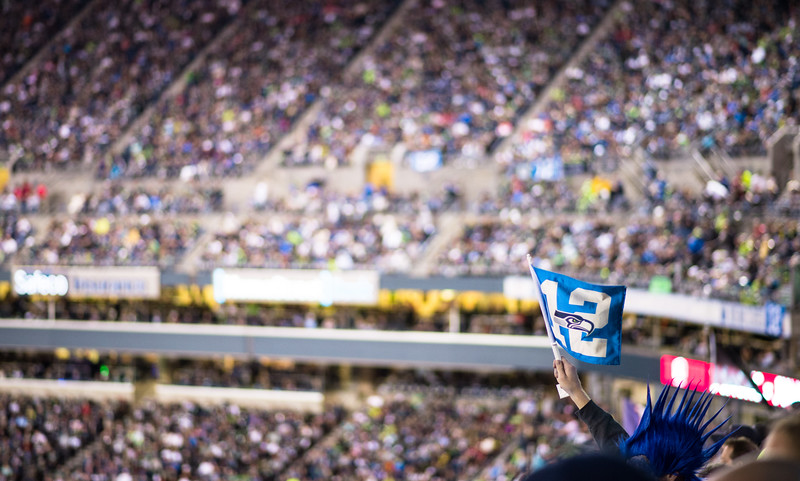 A fan on the Hawks Nest holds up a 12th man flag during third quarter.