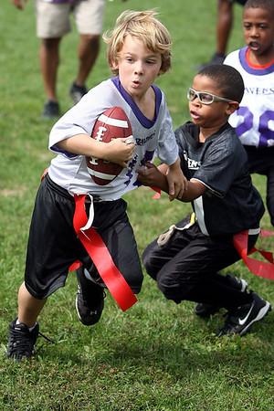 Chris Ammann/Baltimore Examiner Kyle Fehr, left, avoids defender Marcus Wilson as he runs down the field for a touchdown.
