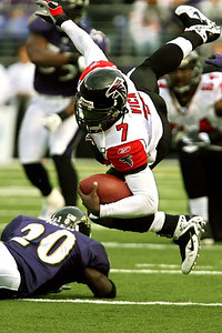 Chris Ammann/Baltimore Examiner Falcons quarterback Marcus Vick is upended after a hit by Ravens safety Ed Reed during a game Sunday, Nov. 19, 2006 in Baltimore.