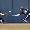Outfielder Macy Jones (12) reaches to catch a bounce off of Lexi Knief's glove for an out during Penn State's 13-4 loss against Purdue on Saturday, March 22, 2014.<br /> ©The Daily Collegian