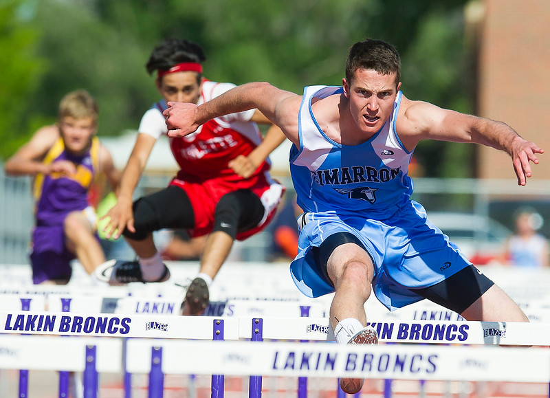 Cimarron High School's Nick Ast leaps over a hurlde, well ahead of his opponents during the boys 110 meter hurdles Friday.