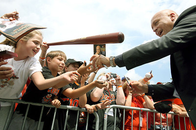 Oriole Hall of Fame inductee Cal Ripken, Jr. signs autographs for fans outside of Doubleday Field during the National Baseball Hall of Fame's Induction Weekend in Cooperstown, NY on Saturday, July 28, 2007. Chris Ammann/Examiner