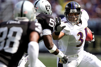 Chris Ammann/Baltimore Examiner Ravens running back Jamal Lewis, right, tries to allude two Raiders defenders during Baltimore's  28-6 win over Oakland at M&T Bank Stadium on Sunday, Sept. 17, 2006. On Sunday, Lewis became the Ravens' all-time combined yardage leader.