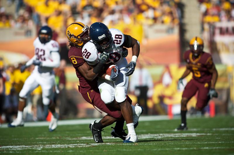Arizona State linebacker Brandon Magee takes down a University of Arizona player