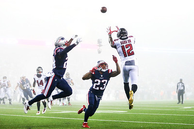 Mohamed Sanu #12 of the Atlanta Falcons catches a pass as he is defended by Patrick Chung #23 of the New England Patriots during the fourth quarter of a game against the Atlanta Falcons at Gillette Stadium on October 22, 2017 in Foxboro, Massachusetts.