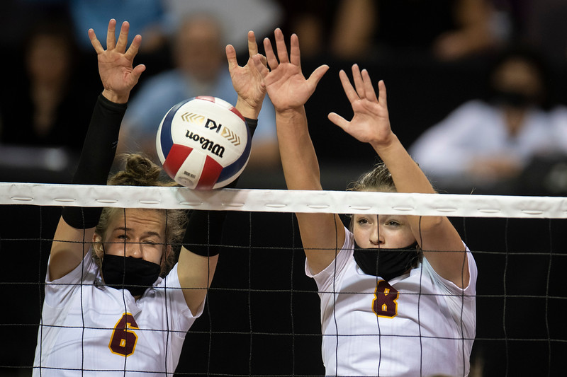 Windsor's Julia Bohlinger (6) and Windsor's Sara Scott (8) block the ball in the third set of the semifinal game against Mead during the 4A state tournament at Broadmoor World Arena in Colorado Springs, Colo. on Thursday, May 13, 2021.