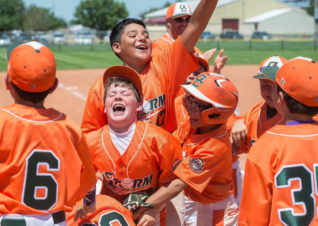 The 11 year-old Cal Ripkin team Garden City Storm celebrate a 13-12 comeback victory against Quivira during the semifinal game at Peebles Park Sunday.