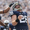 Running back Zach Zwinak (28) celebrates scoring a touchdown in the first half of Penn State's 45-7 victory over Eastern Michigan on September 7, 2013.<br /> ©The Daily Collegian
