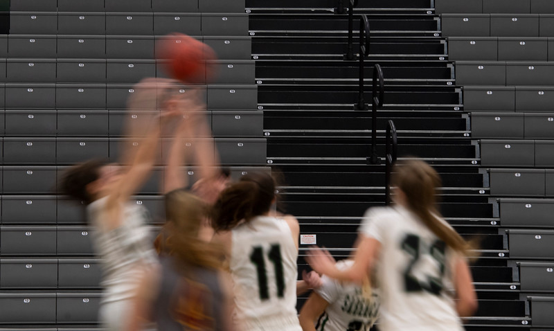 Rocky Mountain and Fossil Ridge girls play in front of empty bleachers at Fossil Ridge High School in Fort Collins, Colo. on Friday, Jan. 29, 2021.