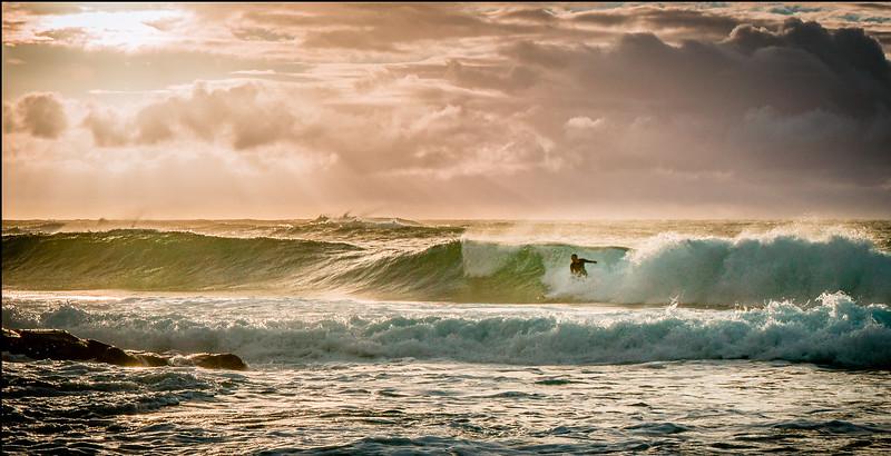 Sunrise surfing at Shipwreck Beach Kauai