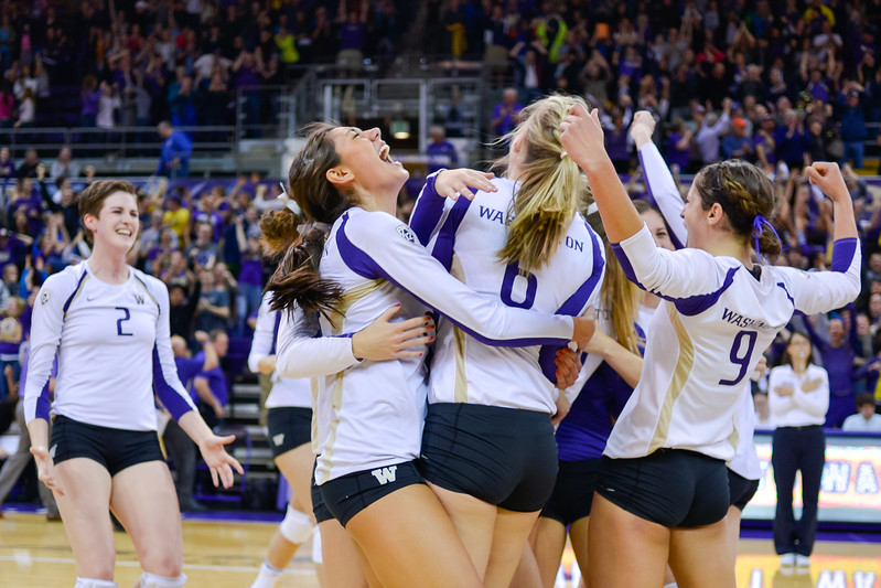 The University of Washington Volleyball team celebrates after they defeat No. 3 Oregon on Nov. 16, 2012.