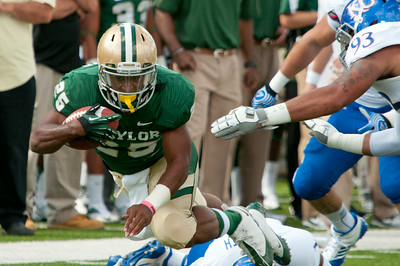 #25 Seastrunk runs over defenders during the KU game.
