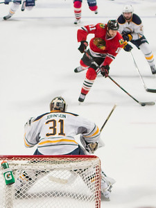 Andrew DesJardens takes a wrist shot at Chad Johnson in the third period.