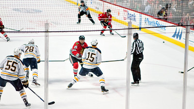 Artem Anisimov wins a draw from Jack Eichel.
