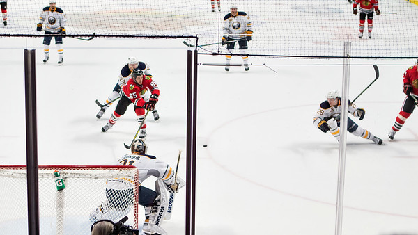 Marian Hossa centers a pass to a streaking Andrew Shaw - two of five.