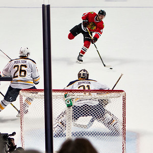 Niklas Hjalmarsson skates for  a shot on goal - two of four.