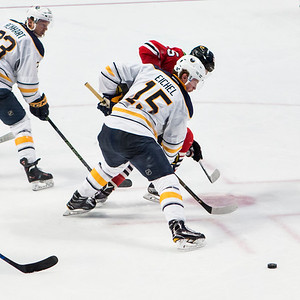Jack Eichel wins a faceoff from Artem Anisimov.