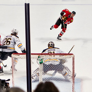 Niklas Hjalmarsson skates for  a shot on goal - three of four.