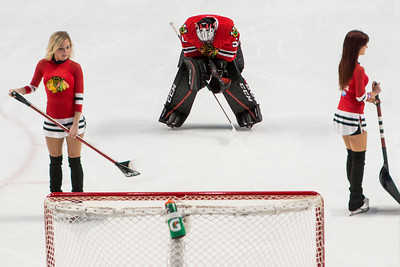 Corey Crawford stretches during  a TV time out.