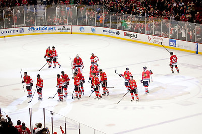 The team gathers to celebrate a 5-3 victory; the team's tenth in a straight win and 23 game without a regulation loss in 2012.